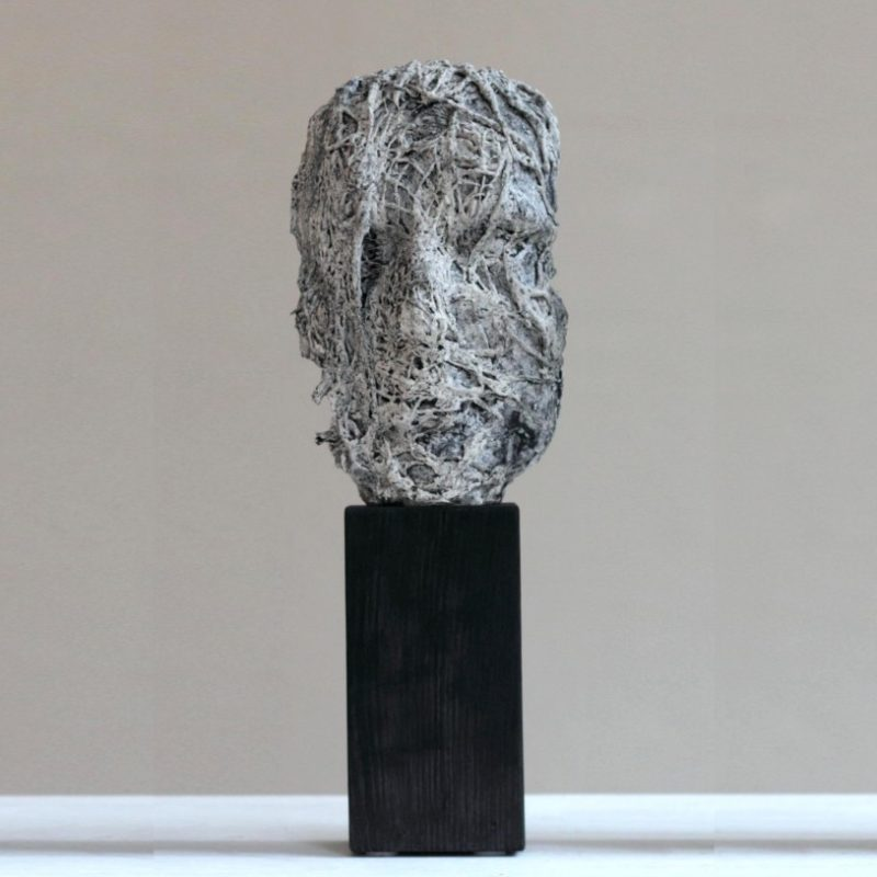 Anna Gillespie Masks (from left 1, 2 & 3), Plaster Resin and Mixed Media on Oak Base Unique h42 cm