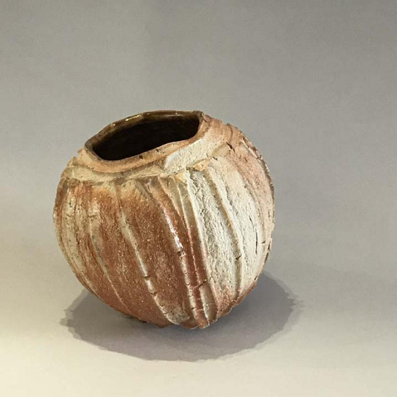 Patricia Shone 15. Small Erosion Jar, Hand formed wood-fired stoneware with tenmoku interior h12 cm.