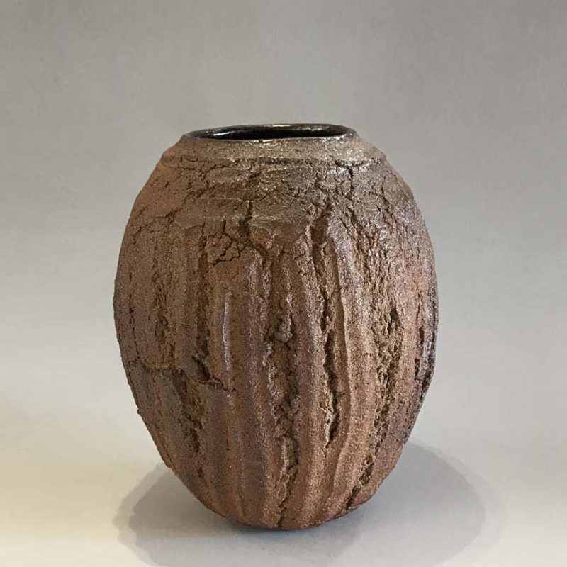 Patricia Shone 17. Erosion Vase, Hand formed crank clay, wood-fired stoneware with tenmoku glaze interior h19 cm.