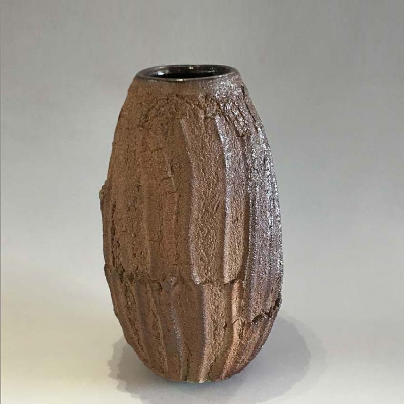 Patricia Shone 18. Erosion Vase, Hand formed crank clay, wood-fired stoneware with tenmoku glaze interior h22 cm.