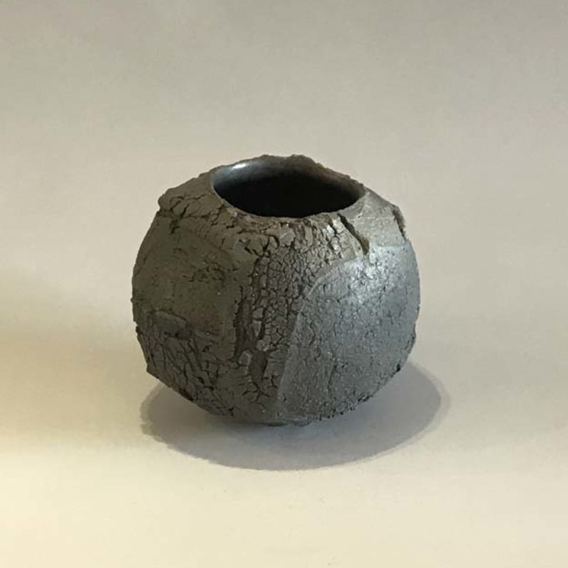 Patricia Shone 20. Small Earth Jar, Hand formed saggar-fired stoneware with iron matte glaze interior h9 cm.