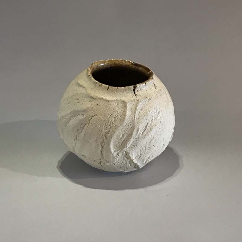 Patricia Shone 22. Small Earth Jar, Hand formed grogged porcelain, wood-fired with amber glaze interior h9 cm.