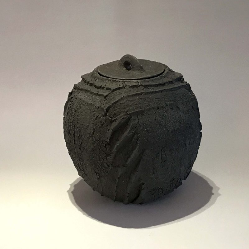 Patricia Shone 1. Lidded Erosion Jar, Hand formed iron matte glazed interior, saggar-fired stoneware ceramic h14 x 12 cm.