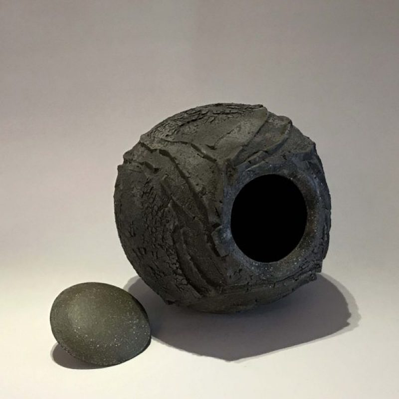 Patricia Shone 2. Lidded Erosion Jar, Hand formed saggar-fired stoneware ceramic with iron matte glaze interior h13.5 x 13 cm.