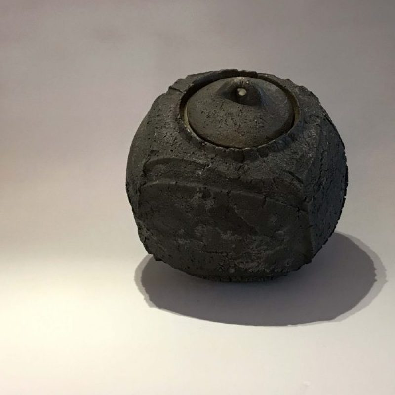 Patricia Shone 3. Lidded Erosion Jar, Hand formed saggar-fired stoneware ceramic with iron matte glaze interior h17 x 15 cm.
