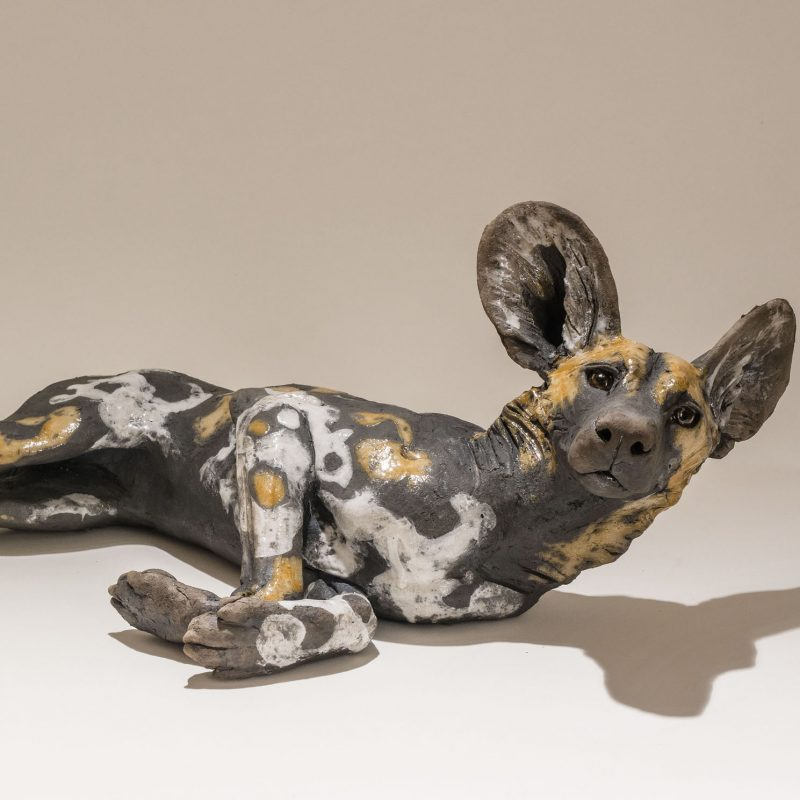 Nick Mackman WDP1. Wild Dog Lying, Low-fired ceramic L56 x h20 cm.