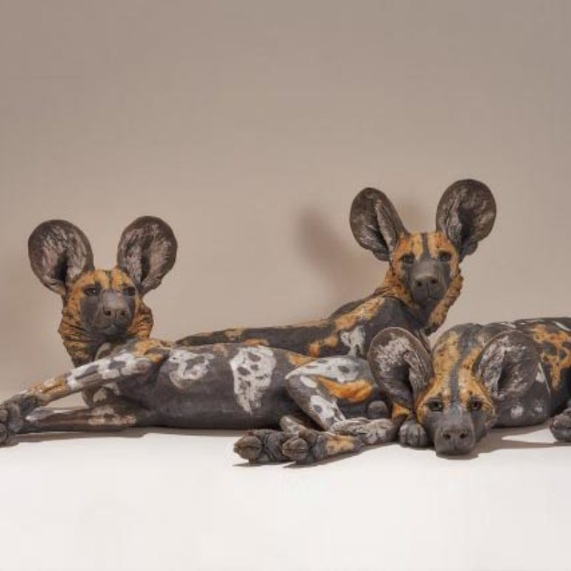 Nick Mackman Wild Dog Pups Resting, Low fired ceramic