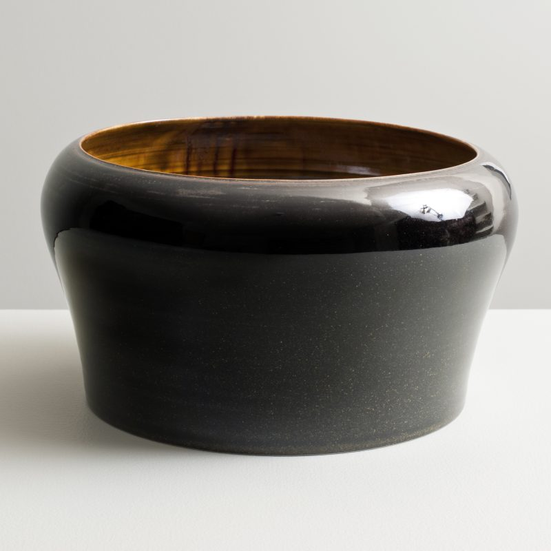Olen Hsu Open Form with Inverted Lip in Running Amber and mirror Black Glazes Porcelain 30 x 22 cm.