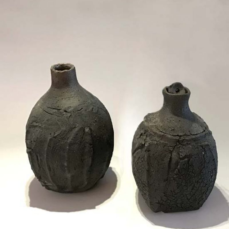 Patricia Shone 7 and 6. Erosion Bottles, Hand formed saggar-fired stoneware with glazed interior h15 x 10 cm. and h14 x 9cm.