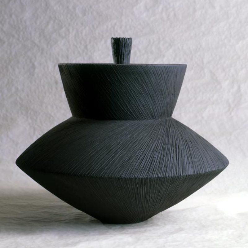 Christiane Wilhelm 1. Container, Stoneware with dark metallic glaze, partly polished h34 x Ø35 cm.