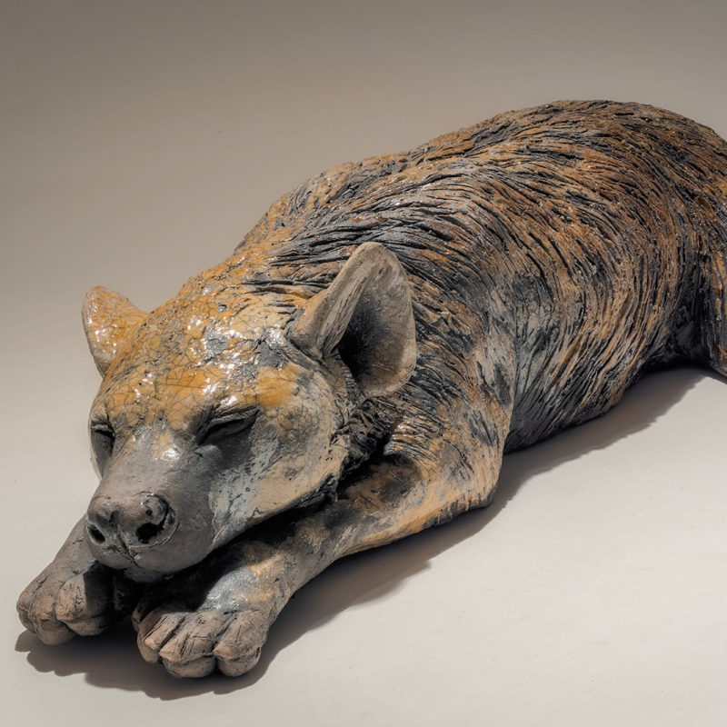 Nick Mackman Spotted Hyena Cub, Low-fired ceramic l56 x w19 x h12 cm.