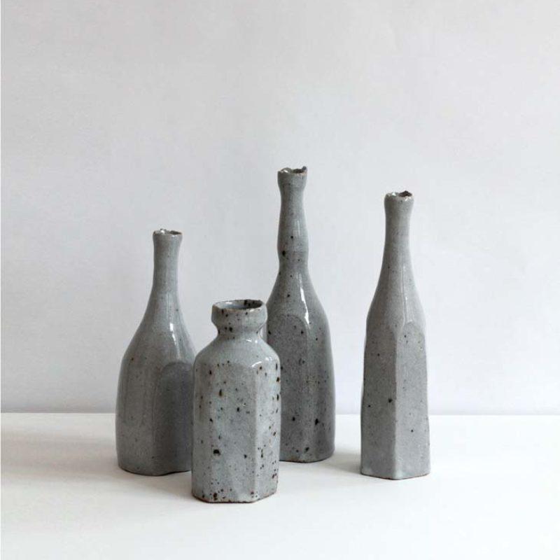 Akiko Hirai (from left) H34, H44, H35, H33 Blue Bottles, Stoneware h17, h12.5, h20, h19 cm.